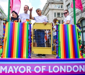 London Mayor Sadiq Khan (C) and Deputy Mayor for Housing James Murray (second left) during the parade at Pride in London.