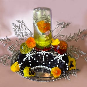 Crescent moon jelly with saffron citrus, pansies, white limonium, candy pearls, saffron pansy jelly and calamansi citrus jelly