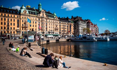 Swedes are still free to gather in public places such as the waterfront in Stockholm.