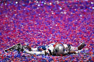 Middle linebacker Kyle Van Noy lies in the confetti after his team's victory