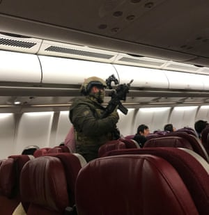 Armed personnel on Flight MH128 after the plane returned to Melbourne