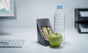 A sandwich and drink at an office desk