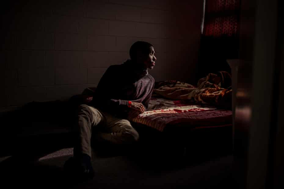 Community health worker Ahmed Dini is seen in his apartment which is located in the Canning Street building in North Melbourne.