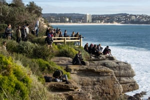 People watch surfers at Deadman's off Shelly Headland