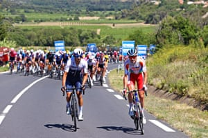 Omer Goldstein Pierre Latour of France are caught by the peloton.