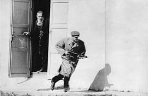 A Turk sprints from the exposed doorway of an old cinema in Limassol, Cyprus, 1964. It was McCullin's first foreign assignment for the Observer.