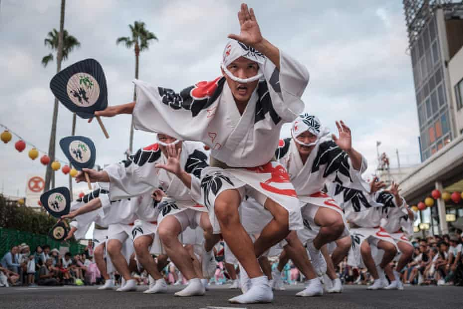 Eiji Ohmatsudani of the Sasa-ren leading dancers on a street during the Awa Odori festival in Tokushima on 13 August. The four-day festival attracts more than 1.2 million people annually