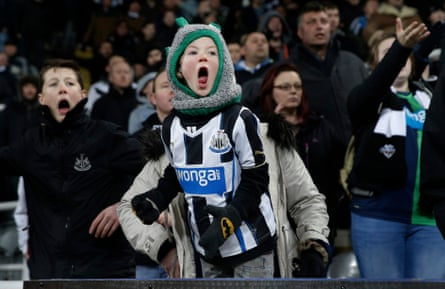 A young Newcastle fan shouts in desperation