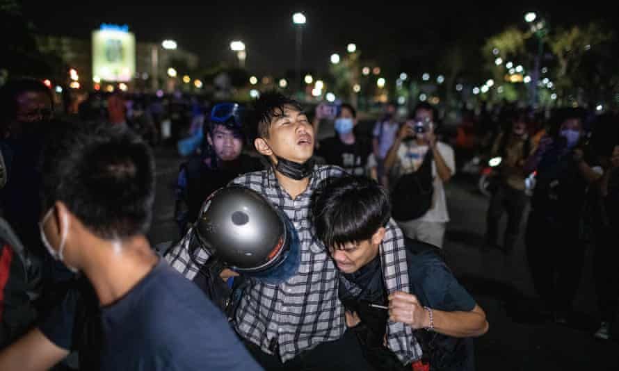 An injured protester during clashes with police in Bangkok, Thailand.