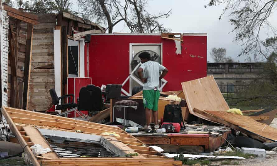 James Sonya surveys what is left of his uncle's barber shop after Hurricane Laura passed through the area on Thursday in Lake Charles, Louisiana.