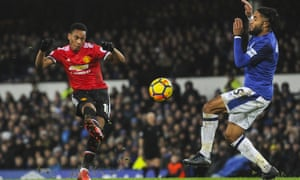 Manchester United's Anthony Martial curls in the opener against Everton.