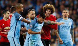 Marouane Fellaini clashes with Sergio Aguero after being sent off.