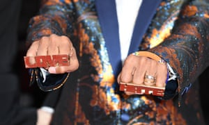 Director Spike Lee wears knuckle rings with love and hate on them as he attends the screening of Blackkklansman during the 71st annual Cannes Film Festival.