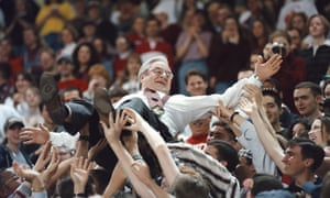 Rev. Jerry Falwell crowd surfs held by students in 1997 during the Big South Tournament semifinal basketball game at Liberty University.