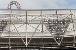 The triangular floodlights have been removed and apparently inverted (they are in fact new structures, though the light fittings have been retained).