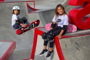 Sky Brown, 11, poses for a picture at Vans Off The Wall Huntington Beach skatepark as her brother Ocean, 8, photobombs the picture.