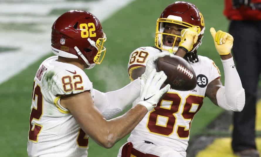 Logan Thomas celebrates his touchdown with wide receiver Cam Sims