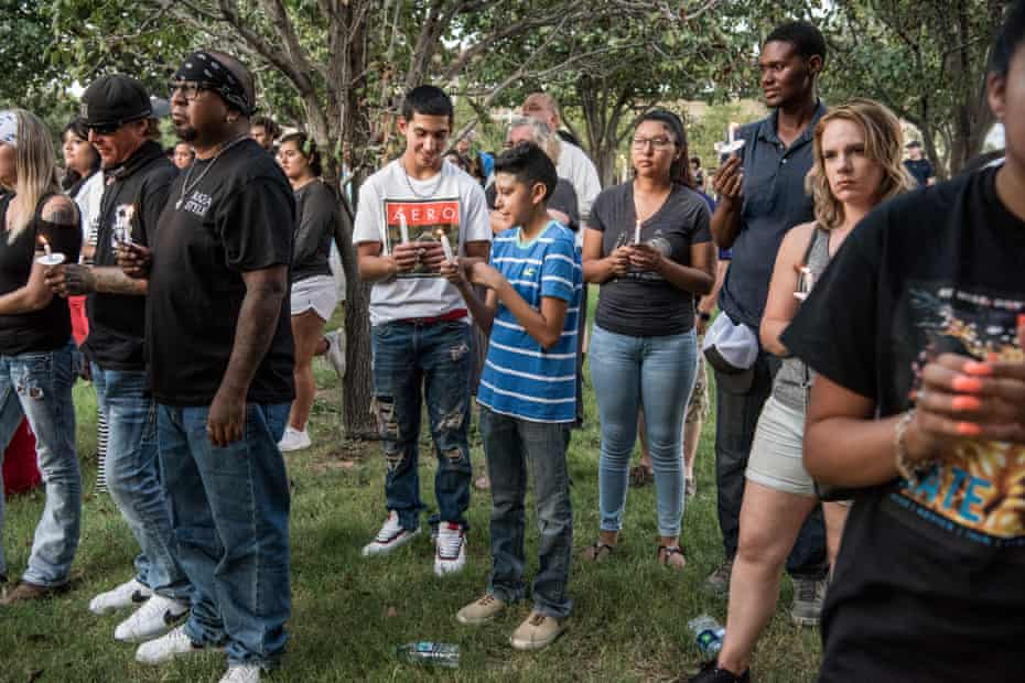 People hold candles at the end of the prayer vigil at the University of Texas of the Permian Basin (UTPB) for the victims of a mass shooting, September 1, 2019 in Odessa, Texas.