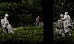 People walk through the Korean war veterans memorial in Washington, DC.