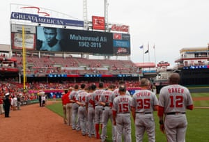 The Washington Nationals stand on the field during a moment of remembrance for Muhammad Ali before a game against the Cincinnati Reds at Great American Ball Park
