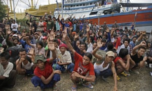 Burmese fishermen raise their hands as they are asked who among them wants to go home at the compound of Pusaka Benjina Resources fishing company in Benjina, Aru Islands, Indonesia.