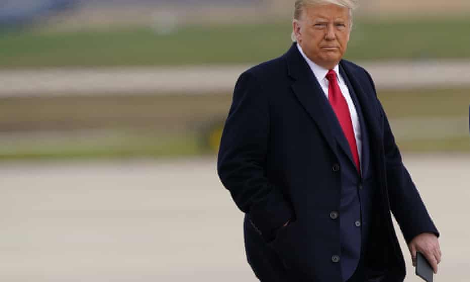 US President Donald Trump holds his phone as he walks towards Air Force One at Andrews Air Force Base, Md., Friday, Oct. 30, 2020.