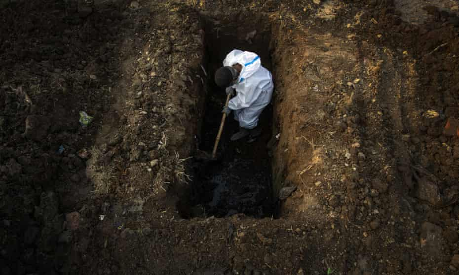 Burying a person who died of Covid-19 in Gauhati, India April 2021