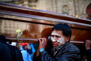 A man carries a coffin before riot police fired tear gas to break up the funeral procession that turned into an anti-government demonstration.