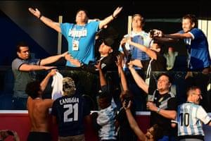 Retired Argentina forward Diego Maradona poses