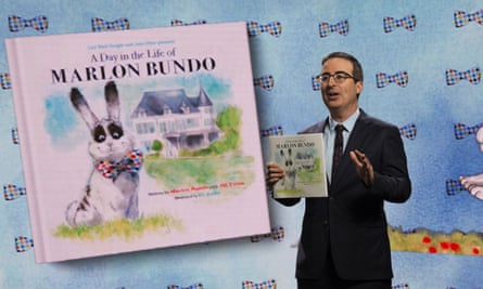 John Oliver holds the book A Day in the Life of Marlon Bundo on his HBO show in 2018.
