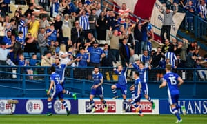 Steven Fletcher, second left, leaps in celebration with cheering Sheffield Wednesday fans after scoring their second goal against Newcastle.