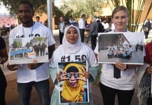 Civil society and youth groups call for urgent climate action as they demonstrate outside the UN climate talks in Marrakech.