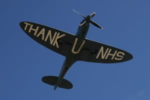 A spitfire plane performs a fly past in support of the NHS.