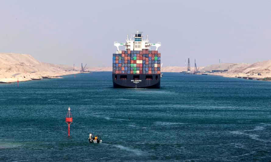A container ship sails through the Suez canal in Ismailia, Egypt.