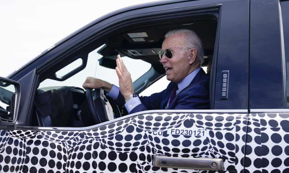 Biden in the electric Ford F150 in Dearborn in May. The president wants to dramatically increase the number of electric vehicles on the road and the infrastructure for manufacturing them.