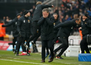 January 19: Leicester City manager Claude Puel reacts as Wolverhampton Wanderers staff celebrate Diogo Jota's late goal.