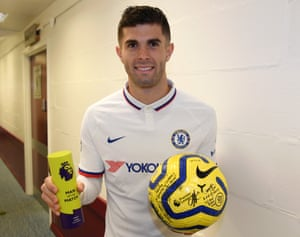Chelsea's hat-trick hero Christian Pulisic proudly shows off the matchball and the Man of the Match award.