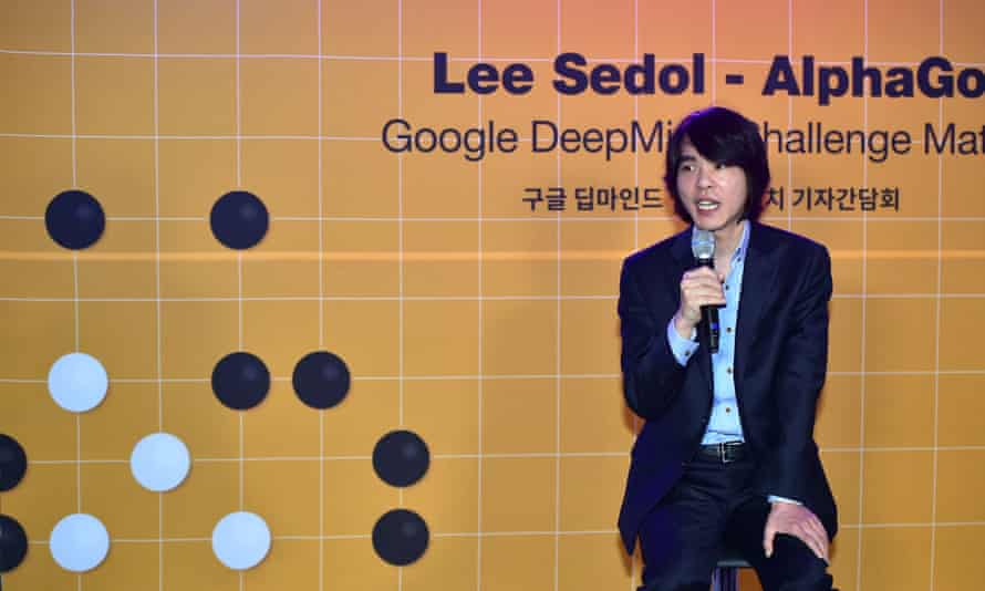 Lee Se-Dol, a legendary South Korean player of Go - a board game widely played for centuries in East Asia - speaks beside a backdrop of a Go board and its pieces (L) during a press briefing on the Google DeepMind Challenge Match at Korea Baduk Association in Seoul on February 22, 2016