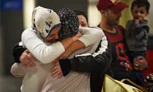 An Iraqi family from Woodbridge, Virginia, welcomes their grandmother who was prevented from entering the country by Trump's first ban, which included Iraq. She was able to return when the ban was halted by a federal judge.