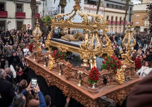 Crowds watch the traditional Holy Week procession in Huelva, Spain.