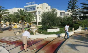 The scene outside the Imperial Marhaba hotel near the Tunisian resort town of Sousse. At least five British tourists and one Irish woman were reported dead.