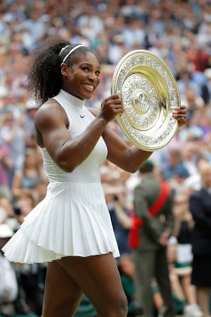 Serena Williams with the trophy after victory in the womens singles final Wimbledon 2016.