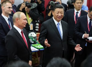 Russia's President Vladimir Putin and China's President Xi Jinping (L-R) attend an event held at the Okean [Ocean] Russian Children's Centre in Vladivostok to mark the 10th anniversary of the 2008 Wenchuan earthquake after which the centre invited Chinese children for rehabilitation.