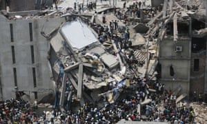 People rescue garment workers trapped under rubble at the Rana Plaza building after it collapsed, in Savar, 30 km (19 miles) outside Dhaka April 24, 2013