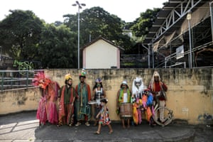 Rio de Janeiro, BrazilSArtists wear costumes during a presentation of the show 'Gigantes Sonhadores' (Giant dreamers) at a school in a favela. The show featuring stilts, unicycles, and acrobatics was inspired by popular stories of enchanted beings and ancestral spirits that underlie popular celebrations in the country, such as the carnival