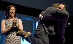 Making the jump ... Kathleen Kennedy looks on as Episode VIII director Rian Johnson embraces Star Wars Celebration chair Pablo Hidalgo