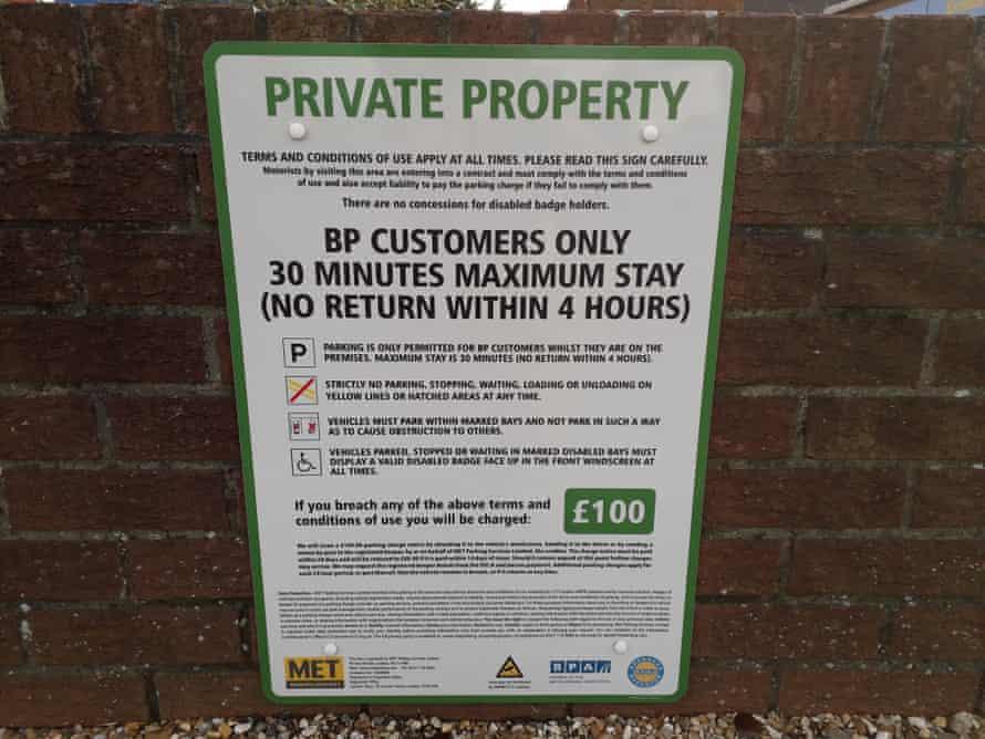 Warning sign at the back of customer car parking at the BP service station in Croydon