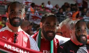 Arsenal fans wearing Alexandre Lacazette masks at the Community Shield