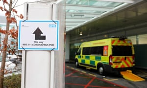A sign directs patients towards a coronavirus pod at St Thomas' hospital in London.