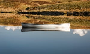 'It … braids itself to browndreadlocks of estuary' … reflection of a lapstrake rowing boat.